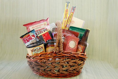 The Bachelor's Basket is full of tasty read-to-eat snacks and easy-to-cook packaged foods like beef and turkey jerky, chips & salsa, peanuts, pretzels, sausage, crackers, ramen noodles, ravioli and marinara sauce, with a ginger beer thrown in for fun.