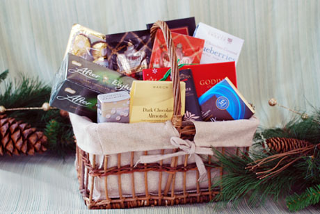 The Chocoholics Basket contains an array of gourmet chocolate items that will satisfy even the biggest sweet tooth. Chocolate covered almonds, a selection of Godiva dark chocolates, chocolate covered blueberries, hot cocoa, chocolate mint cookies and more.